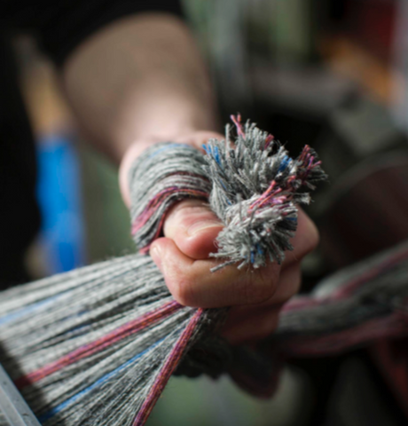 WEAVERS PREPARING THE LOOM IN THE OUTER HEBRIDES FOR LUXURY BRITISH SUSTAINABLE PETWEAR BRAND LISH