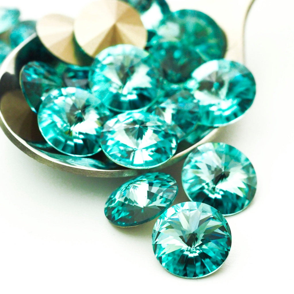 4 - Swarovski Light Turquoise 12mm Rivoli Beads - 100% Guarantee