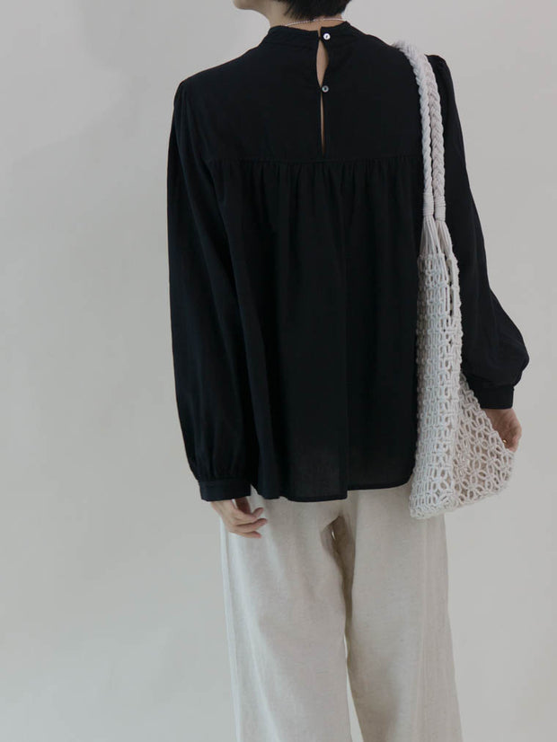 Stand-up collar puff sleeve shirt in classic black