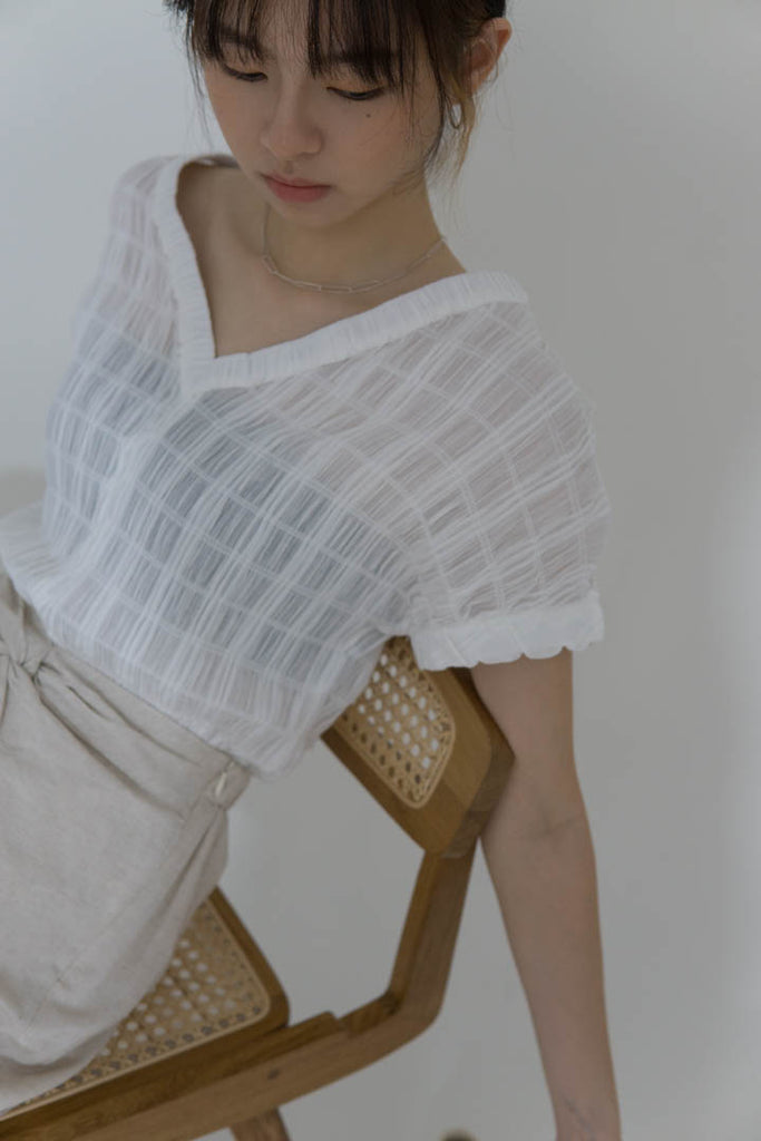 Pleated V-neck top in cream white