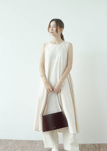 Double pocket sleeveless vest dress in almond color