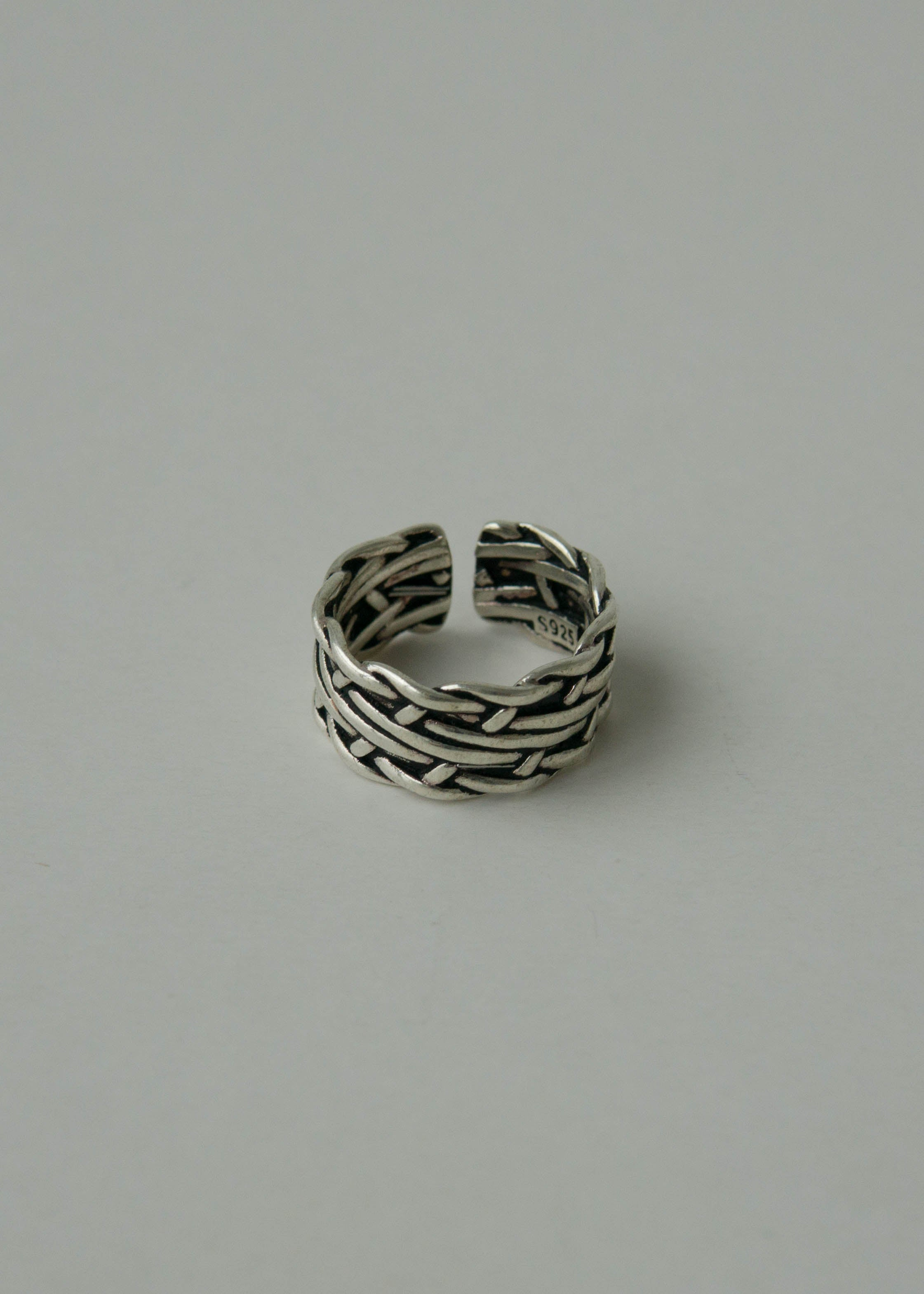 Woven knotted winding cross ring