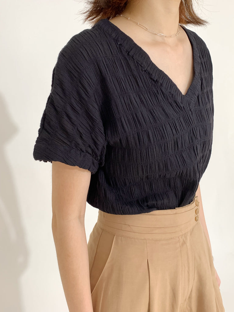 Pleated V-neck top in classic black