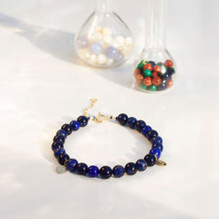 The Alkemistry 18ct yellow gold Lapis and blue goldstone Cinta bracelet