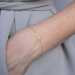Sydney Evan 14ct gold and diamond 'love' bracelet