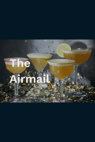 The airmail cocktails with lime garnishes and confetti strewn about