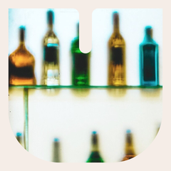 Intentionally blurry image of bottles on a shelf