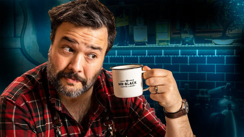 YouTube thumbnail of Greg Titian holding a Mr Black Coffee Mug for the How To Drink Episode Irish Coffee, History, & Twists
