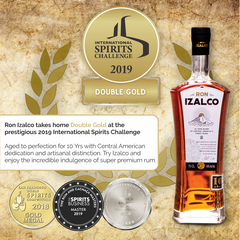 A bottle of Ron Izalco Rum and the various award medals it has won.