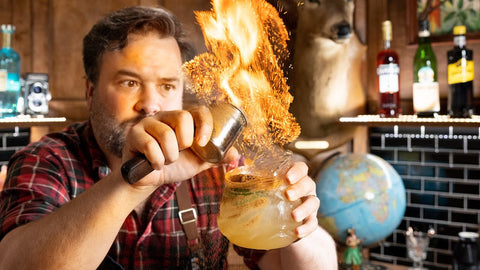 Man from How to Drink YouTube show setting a cocktail on fire
