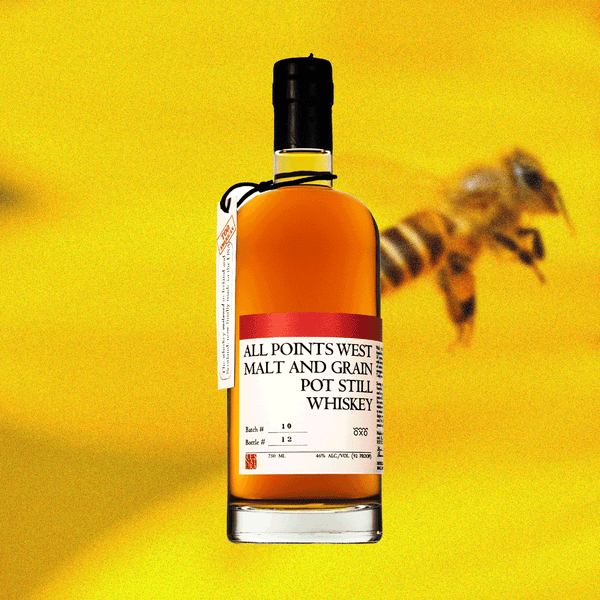 All Points West Malt and Grain Pot Still Whiskey is an award winning one-of-a-kind American Whiskey. Image of bottle on a yellow background with a bee.