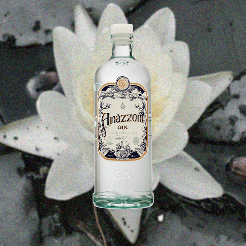 Bottle of Amazzoni Gin over a background of a faded white flower