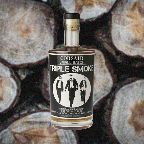 Corsair Small Batch Triple Smoke American Malt Whiskey bottle image over logs.