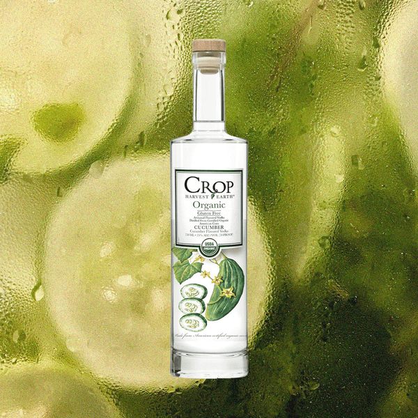 Image of Organic Crop Cucumber Vodka over green image with rain drops