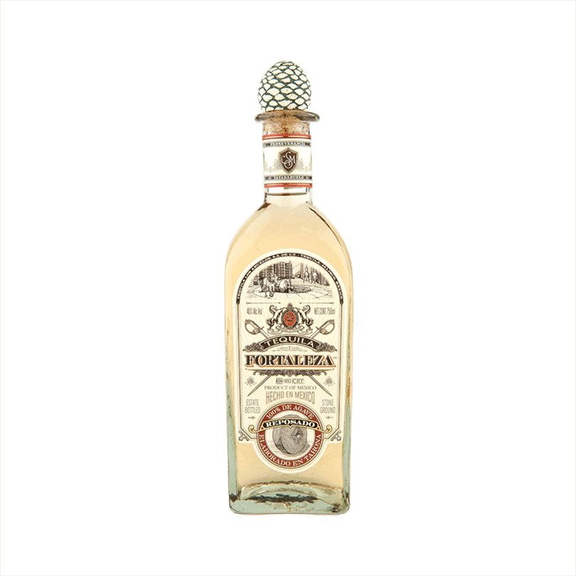 Bottle of Fortaleza Tequila Reposado the label is vintage with red details. The top of the bottle has the signature agave cork topper.