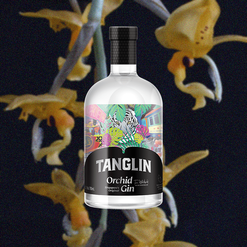 Bottle of Tanglin Orchid Gin over backdrop image of yellow flowers and a dark background.