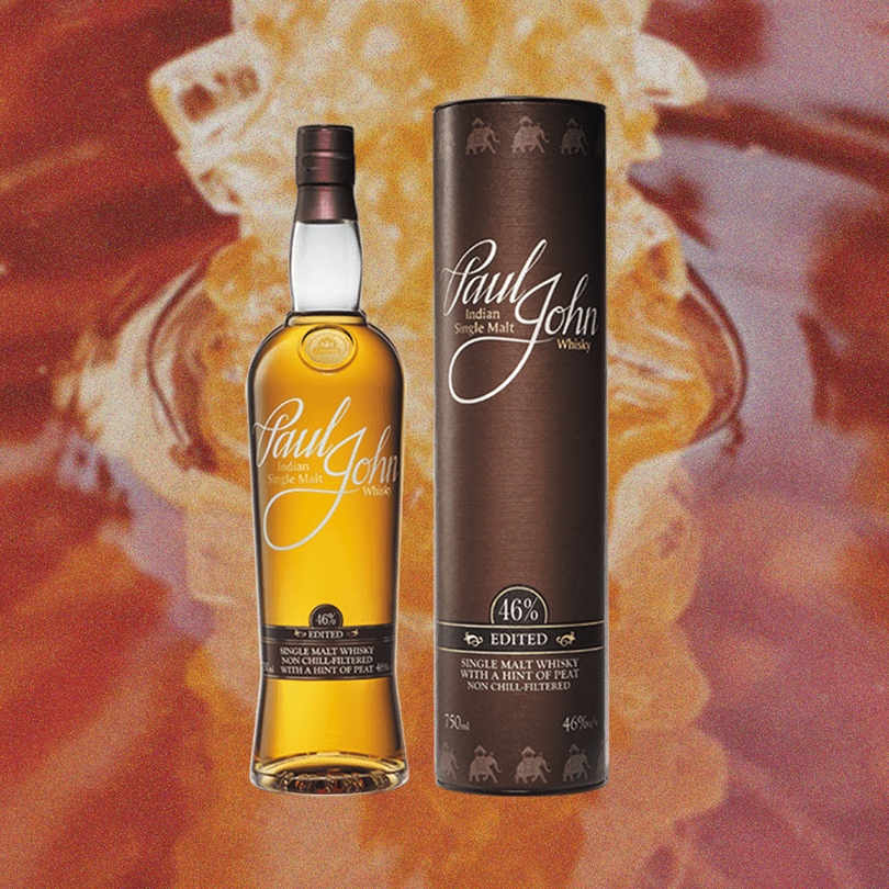 Bottle image of Paul John Edited Whisky and the package the box goes in. A backdrop of red and yellow swirl.