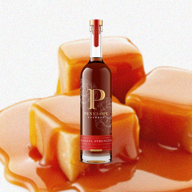 Bottle of Penelope Bourbon Barrel Strength over a backdrop of delicious looking caramel.