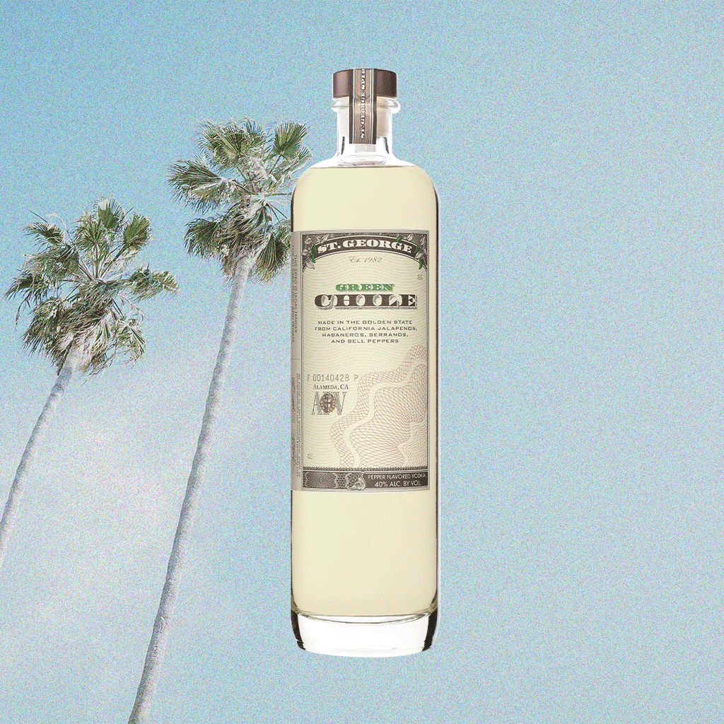 Bottle image of St. George Green Chili Vodka. Background image of palm tree and blue sky.