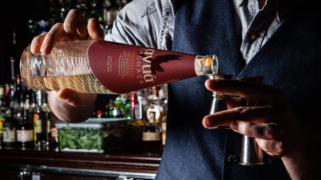 Image of bartender pouring Avua Amburana Cachaca into a jigger.