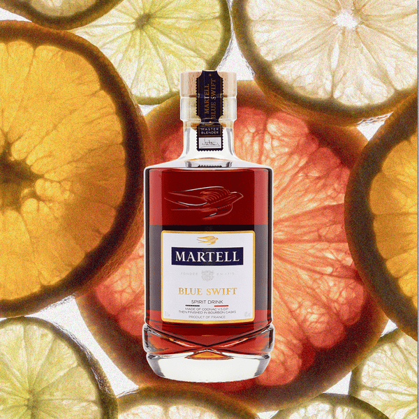 Bottle image of Martell Blue Swift Cognac, an award-winning unique spirit. Image backdrop of citrus fruit.