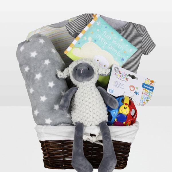 Lamb Fun Neutral Basket<BR>Celebrate the arriving of newest little package with a gift thoughtfully design for Baby! This lovable gift basket features a beautiful cable knit blanket, a 100% cotton sleeper, Baby Toys, 100% Blankets and More - Baby Gifties