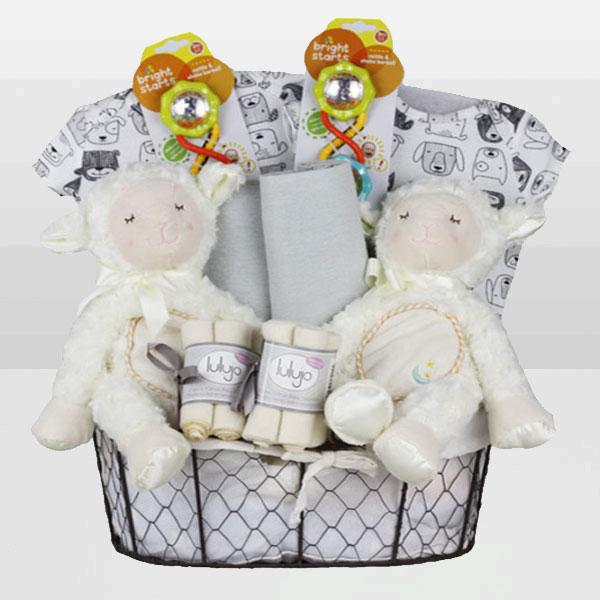 Twins Neutral Lamb Basket<BR>This lovable gift basket features a beautiful cable knit blanket, a 100% cotton sleeper, Baby Toys, 100% Blankets and More - Baby Gifties