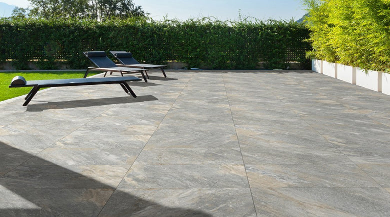 Quartzite porcelain paving tiles laid on cement screed