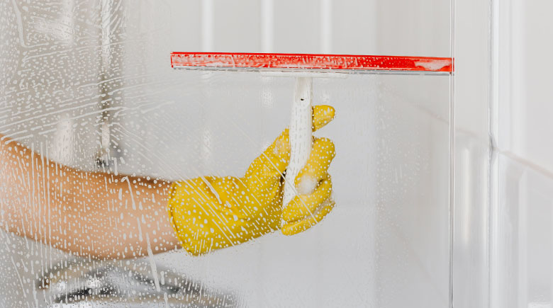 Squeegee cleaning shower