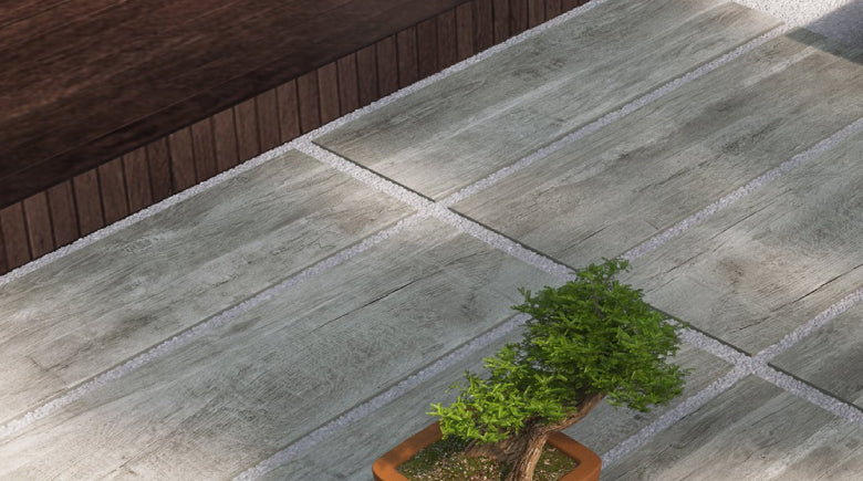 Wood effect paving tiles laid on gravel in garden