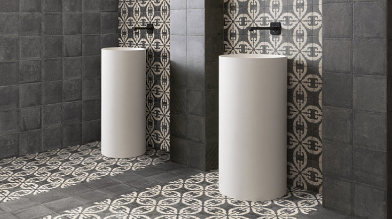 dark grey and pattern tiles with bathroom sinks