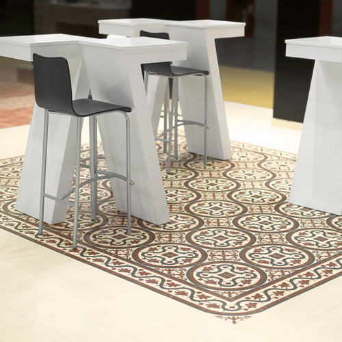 Lifestyle image of Victorian Nou pattern tiles used on the floor of a dining room