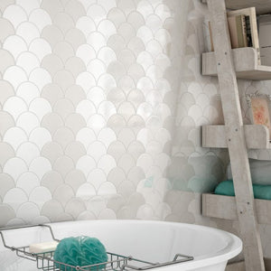 White and grey fan shaped tiles in bathroom