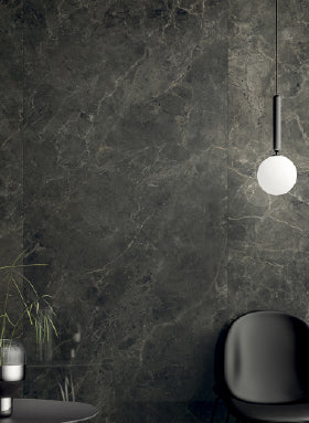 Black marble tiles on wall
