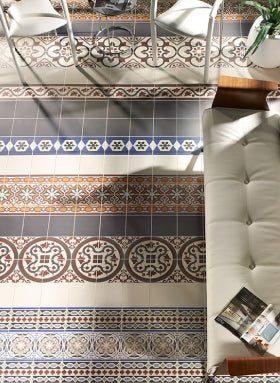 Pattern tiles on floor and wall of living room
