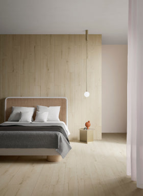 Light coloured Wood Effect tiles on floor and wall of bedroom