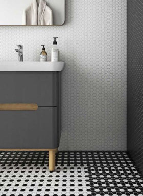 Miniworx black and white hexagonal mosaic tiles on bathroom floor and wall