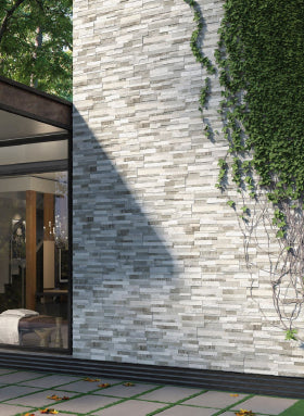 Grey stone effect cladding on exterior house wall