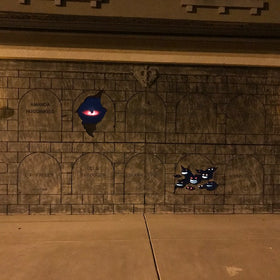 Turn Your Garage Door into a Haunted Mausoleum