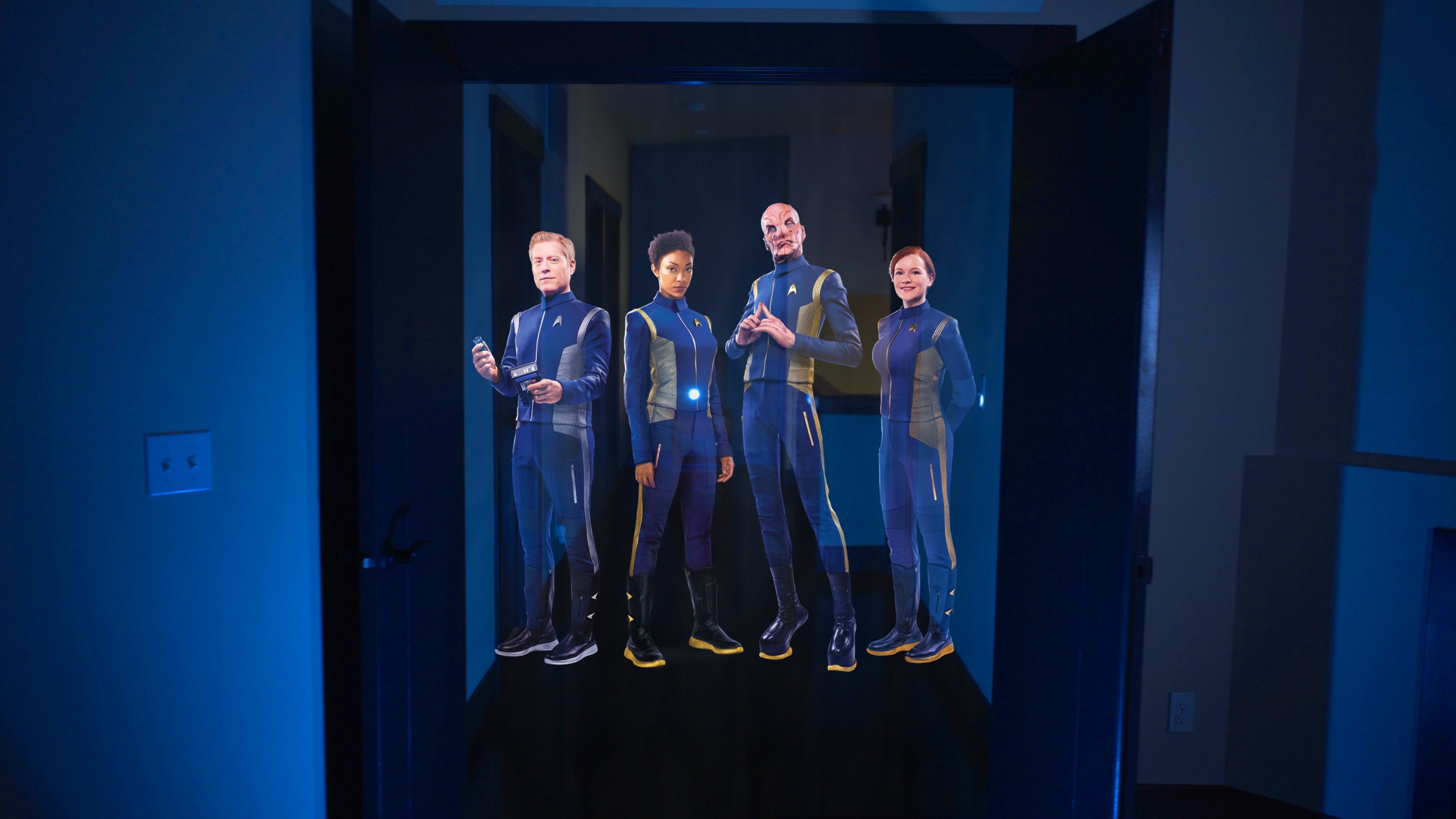 The crew from Discovery appears as a hologram-like illusion in your hallway