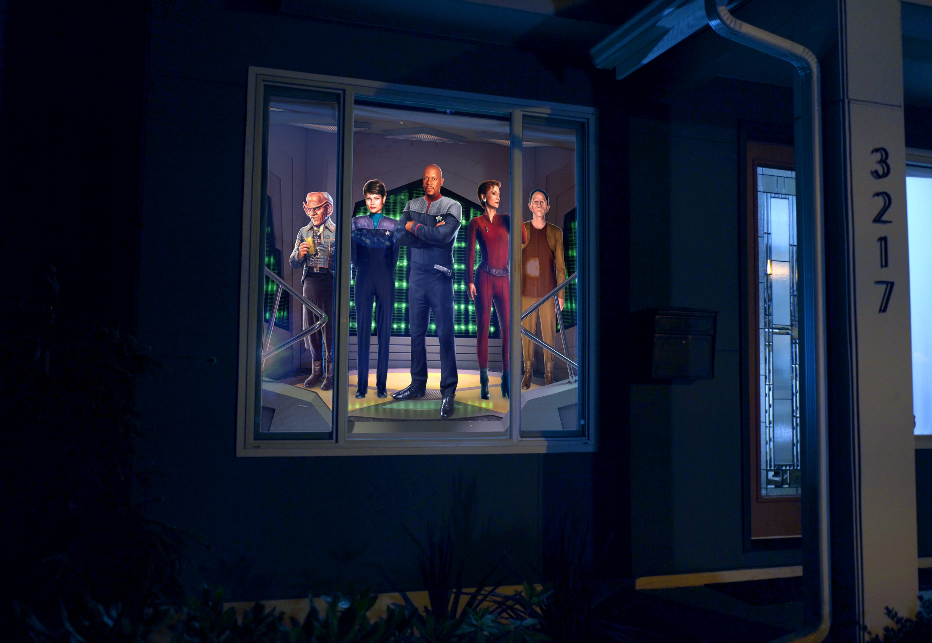 The crew of Deep Space Nine decorating a front window