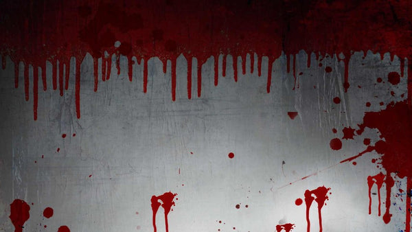 dripping blood and blood spatters on a wall