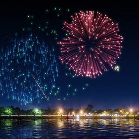 digital fireworks exploding over water