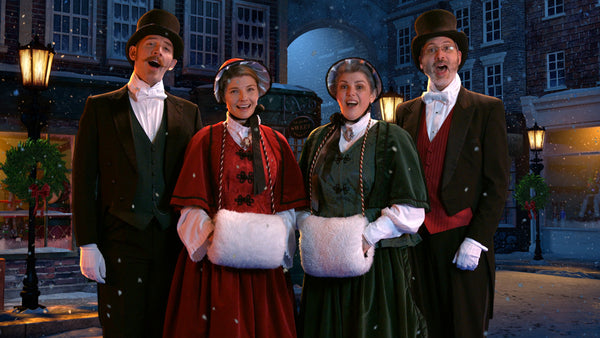 4 Victorian-style Christmas carolers