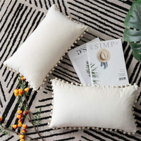 DEZENE Throw Pillow Covers with Pom-poms, 2 Pack Super Soft Velvet Decorative Pillow Cases, Luxury Accent Rectangular Pillowcases, Lumbar Cushion Covers for Farmhouse,Couch,Sofa, 12x20 Inch, Cream