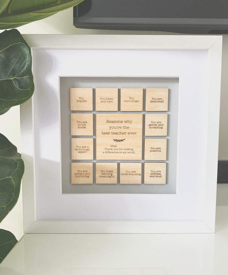 """Reasons why you're the best teacher/educator"" timber tiles set in a wooden frame"