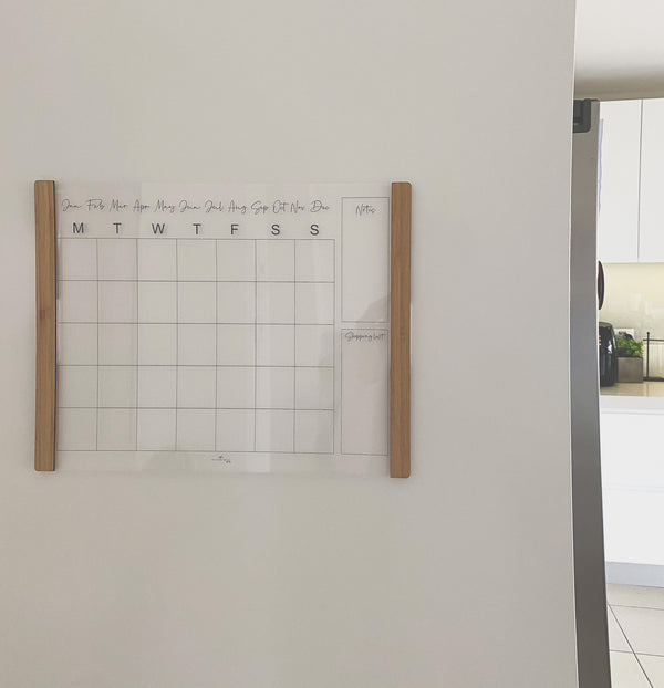 Velcro-mounted acrylic monthly planner with bamboo accents