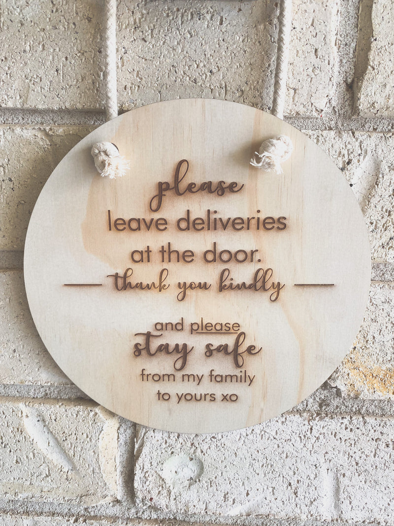 Please leave deliveries at the door - plaque with rope