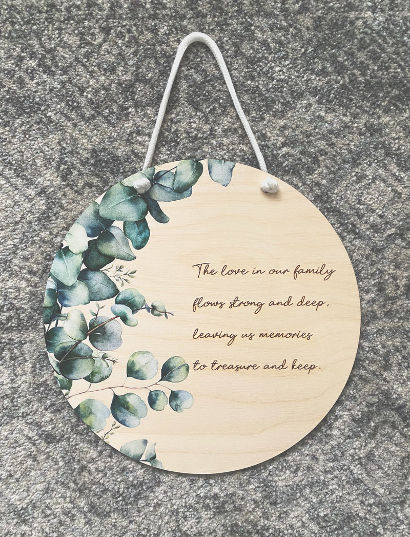 "Eucalyptus printed plaque with ""family"" quote"