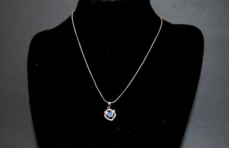 Sara's Fashion cute necklace incorporates a blue jewel for a hint of color made of real Silver